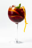 Cocktail with orange. Red cocktail with ice and orange Royalty Free Stock Photo