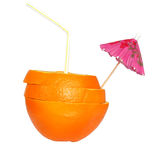 Cocktail of orange with a straw and an umbrella Stock Image