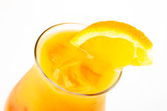 Cocktail with orange. Yellow cocktail with ice and orange Royalty Free Stock Photo