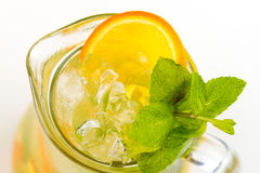 Cocktail with orange. Yellow cocktail with ice and orange Stock Images