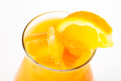 Cocktail with orange. Yellow cocktail with ice and orange Royalty Free Stock Image