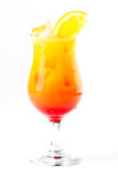 Cocktail with orange. Yellow and red cocktail with ice and orange Royalty Free Stock Image