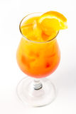 Cocktail with orange. Yellow and red cocktail with ice and orange Stock Photos