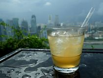 Cocktail with a panoramic city skyline stock photography