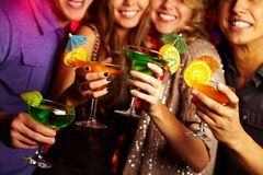 Cocktail party. Young people having fun at a party with cocktails Stock Photos