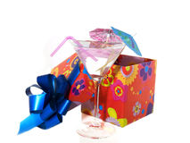 Cocktail party. Cocktail glass with present and a umbrella Royalty Free Stock Photos