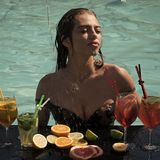 Cocktail party. Cocktail and girl in pool. stock photography