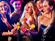 Cocktail party with group people dancing and drink cocktail. Woman disco night club. Cocktail party with group people dancing and drink cocktail. Women and men royalty free stock photo