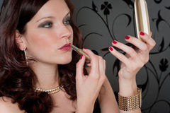 Cocktail party woman evening dress apply lipstick. Cocktail party woman in evening dress apply red lipstick look mirror Royalty Free Stock Photos