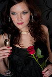 Cocktail party woman evening dress champagne rose Royalty Free Stock Photo