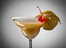 Cocktail with physalis , cherry and lemon Royalty Free Stock Image