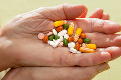 Cocktail of pills and tablets in an elderly hand Royalty Free Stock Photography