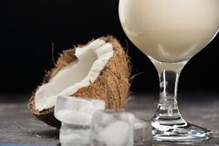 Cocktail pina colada. Alcoholic beverage with straws, slice of pineapple and little cocktail umbrella Royalty Free Stock Images