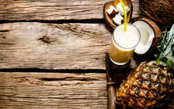 Cocktail pina colada. Fresh cocktail with coconut, rum and pineapple on a wooden table. Free space for text royalty free stock photos