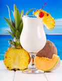 Cocktail pina colada with fresh fruits Stock Images