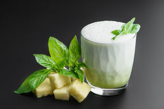Cocktail `pineapple and basil` healthy drink. Cocktail `pineapple and basil` healthy food on a dark uniform background with pineapple and pineapple Royalty Free Stock Image