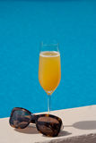 Cocktail by the pool. Bellini cocktail by the pool Stock Image