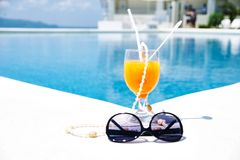 Cocktail with pool background Stock Photography