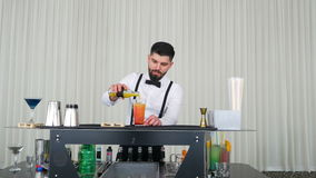 Cocktail preparing technique performed by barman stock footage