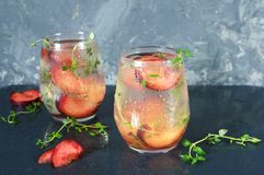 Cocktail of Prosecco. A cocktail of Prosecco with plums and thyme Stock Image