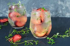 Cocktail of Prosecco. A cocktail of Prosecco with plums and thyme Royalty Free Stock Image