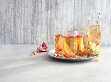Cocktail Prosecco sangria. With pear, grapes, pomegranate Royalty Free Stock Photo