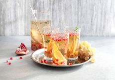 Cocktail Prosecco sangria. With pear, grapes, pomegranate Stock Photo