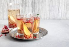 Cocktail Prosecco sangria. With pear, grapes, pomegranate Royalty Free Stock Photos