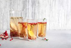 Cocktail Prosecco sangria. With pear, grapes, pomegranate Stock Image