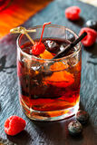 Cocktail with raspberry on background Stock Image