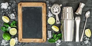 Cocktail rink making tools Lime mint leaves Chalkboard. Cocktail rink making tools. Lime and mint leaves. Chalkboard for recipe text stock images