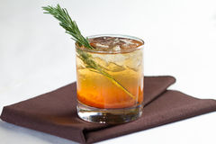 Cocktail. A cocktail in a rocks glass with a rosemary garnish Royalty Free Stock Photography