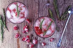 Cocktail, rosemary, alcohol, berry, raspberry strawberry, party,. Alcoholic Cocktail. Fruity cocktail drink with the addition of alcohol is decorated with frozen Stock Image
