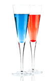 Cocktail rosso e blu dell'alcool di Champagne Fotografia Stock