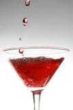 Cocktail rosso su bianco Fotografia Stock