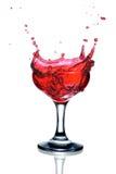 Cocktail rouge avec l'éclaboussure Photographie stock libre de droits