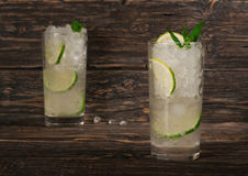 Cocktail with rum in tall glass with ice, lime, mint Stock Images
