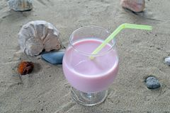 Cocktail on the sand. Beautiful tasty smack Stock Images