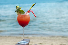 Cocktail at the sea. Red cocktail at the sea with mint and lemone Royalty Free Stock Photos