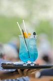 Cocktail service. Two blue cocktails on a tray being served Royalty Free Stock Images