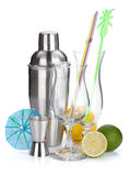 Cocktail shaker, glasses, utensils and citruses Stock Photography