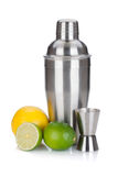 Cocktail shaker with measuring cup and citruses. On white background stock photos