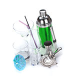 Cocktail shaker, utensils and glasses royalty free stock photo