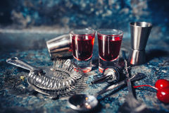 Cocktail shots of beverage. Strong, red vodka shots with cherry and delicios flavours. Royalty Free Stock Photo