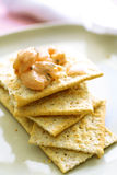 Cocktail shrimps on crackers Stock Photography