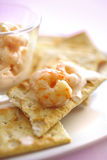 Cocktail shrimps on crackers Royalty Free Stock Photo