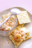 Cocktail shrimps on crackers Royalty Free Stock Photography