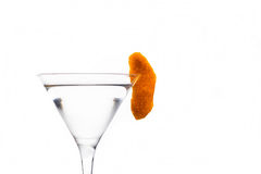 Cocktail with slice of orange zest. In martini glass Royalty Free Stock Photo
