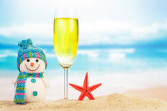 Cocktail and snowman on beach Royalty Free Stock Image