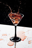 Cocktail splash Stock Images